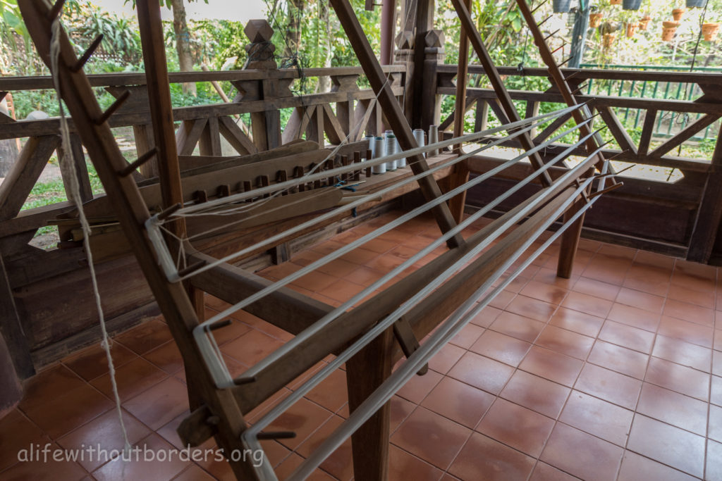 Lao Textile Museum Vientiane hand winding cotton for weaving