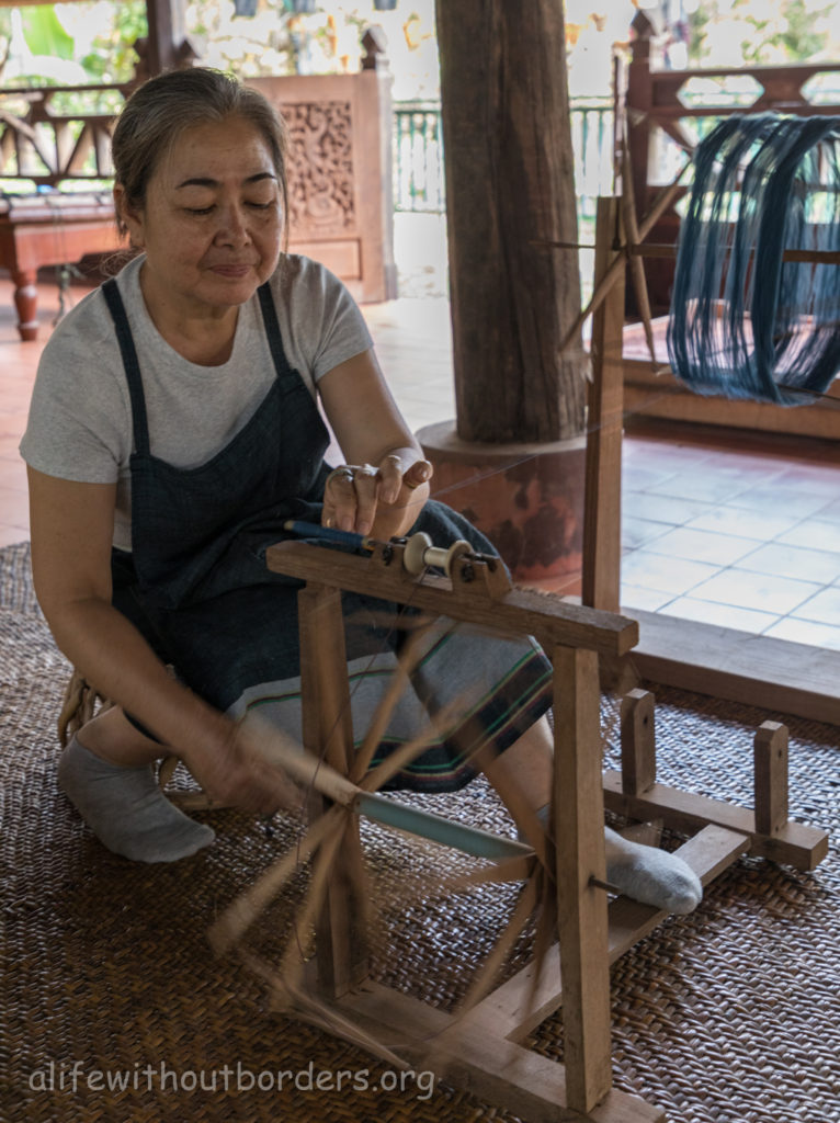Lao Textile Museum Vientiane Hand spinning silk for weaving