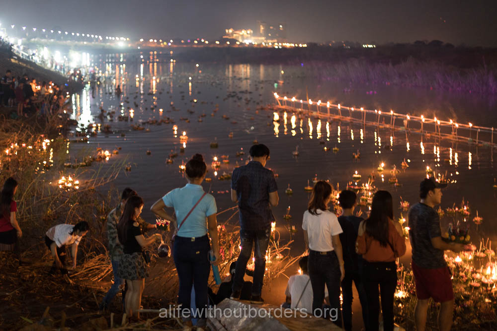 Crowds head to the river for Laos Festival of Lights